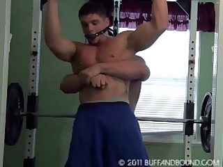 young bodybuilder exposed gym tied